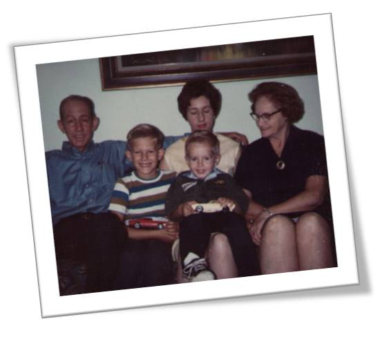 From left to right, my grandpa Dewey, my brother Mike, me on my mother Pauline's lap, and my grandmother Viola